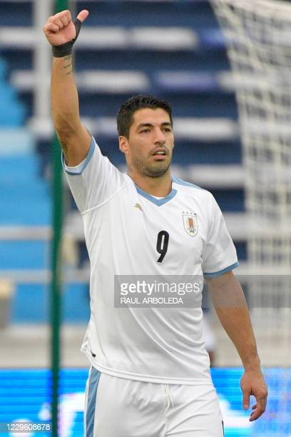 Uruguay's Luis Suarez celebrates after scoring a penalty against Colombia during their closed-door 2022 FIFA World Cup South American qualifier...