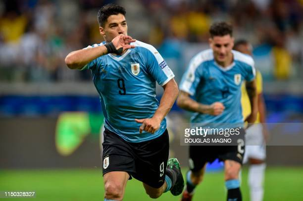 Uruguay's Luis Suarez celebrates after scoring against Ecuador during their Copa America football tournament group match at the Mineirao Stadium in...