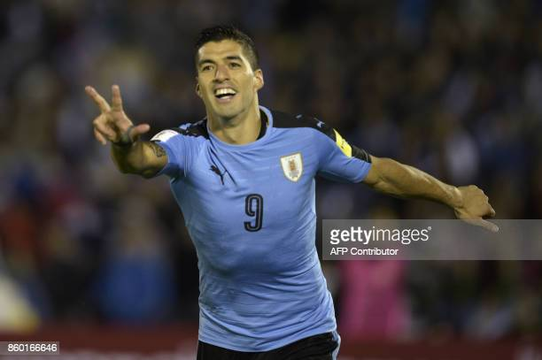 Uruguay's Luis Suarez celebrates after scoring his second goal against Bolivia during their 2018 World Cup football qualifier match in Montevideo on...