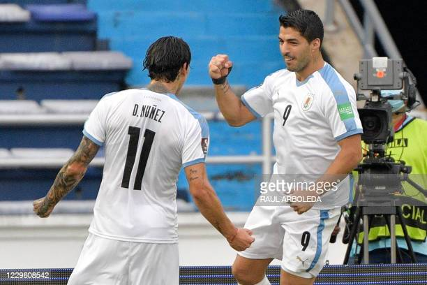 Uruguay's Luis Suarez celebrates with teammate Darwin Nunez after scoring a penalty against Colombia during their closed-door 2022 FIFA World Cup...