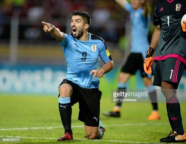 TOPSHOT Uruguay's Luis Suarez gestures during the 2018 World Cup football qualifier match against Venezuela in San Cristobal Venezuela on October 5...