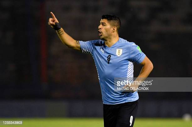 Uruguay's Luis Suarez gestures during the South American qualification football match for the FIFA World Cup Qatar 2022 against Venezuela at the UCV...