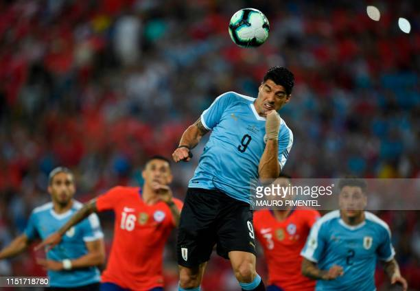 TOPSHOT Uruguay's Luis Suarez heads the ball during the Copa America football tournament group match against Chile at Maracana Stadium in Rio de...