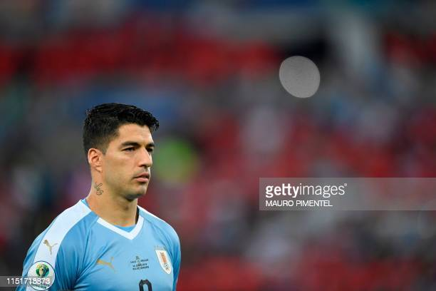 Uruguay's Luis Suarez listens to the national anthems before the Copa America football tournament group match against Chile at Maracana Stadium in...