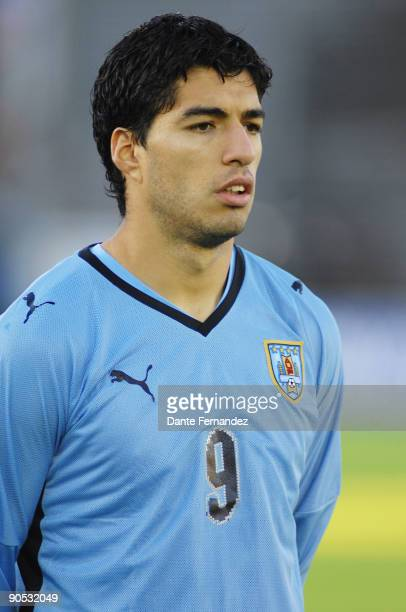 Uruguay's Luis Suarez sings his country's national anthem prior to a 2010 FIFA World Cup qualifier against Colombia at the Centenario Stadium on...