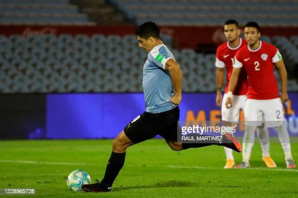 Uruguay's Luis Suarez takes a penalty-kick to score against Chile during their 2022 FIFA World Cup South American qualifier football match at the...