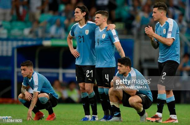 Uruguay's Luis Suarez whose penalty was stopped by Peru's goalkeeper Pedro Gallese watches the penalty shootout along with teammates Lucas Torreira...