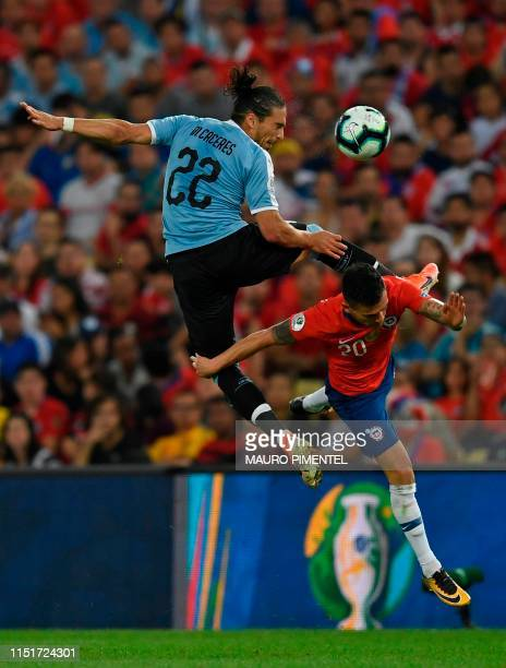 Uruguay's Martin Caceres and Chile's Charles Aranguiz vie for the ball during their Copa America football tournament group match at Maracana Stadium...