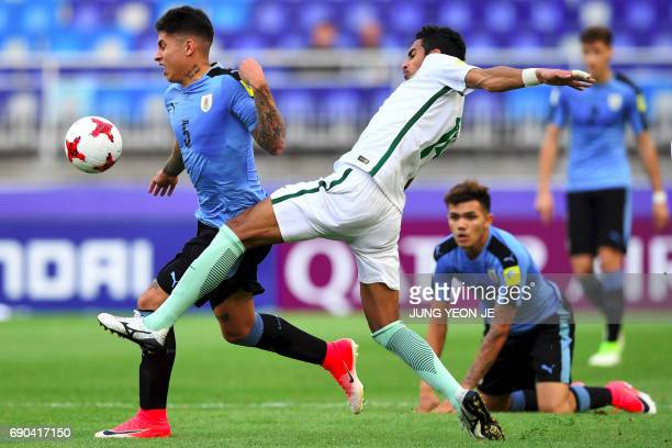 Uruguay's Mathias Olivera fights for the ball with Saudi Arabia's Ali Alasmari during their U20 World Cup round of 16 football match between Uruguay...