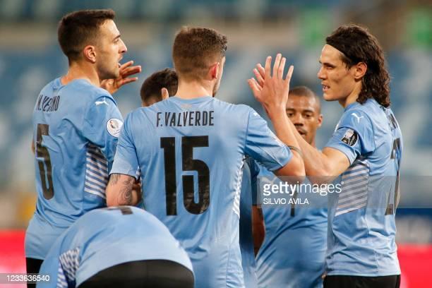 Uruguay's Matias Vecino, Federico Valverde, Nicolas de la Cruz and Edinson Cavani celebrate after an own goal by Bolivia's goalkeeper Carlos Lampe...
