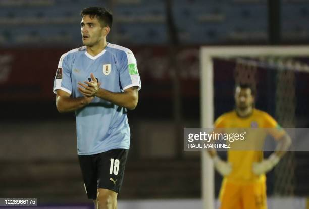 Uruguay's Maximiliano Gomez celebrates with teammates after scoring against Chile during their 2022 FIFA World Cup South American qualifier football...
