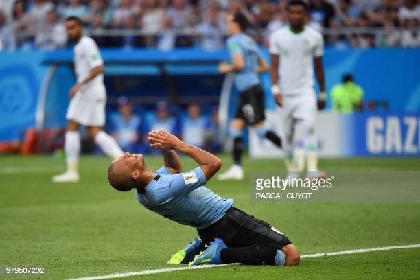 Uruguay's midfielder Carlos Sanchez gestures after missing a goal opportunity during the Russia 2018 World Cup Group A football match between Uruguay...