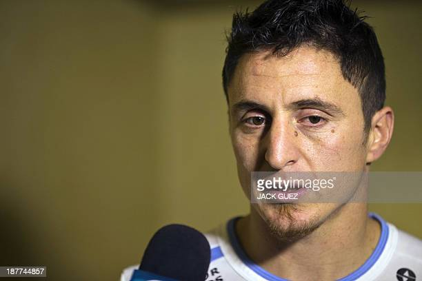 Uruguay's midfielder Cristian Rodriguez answers journalists' questions at his hotel on November 12 2013 on the eve of the FIFA 2014 World...