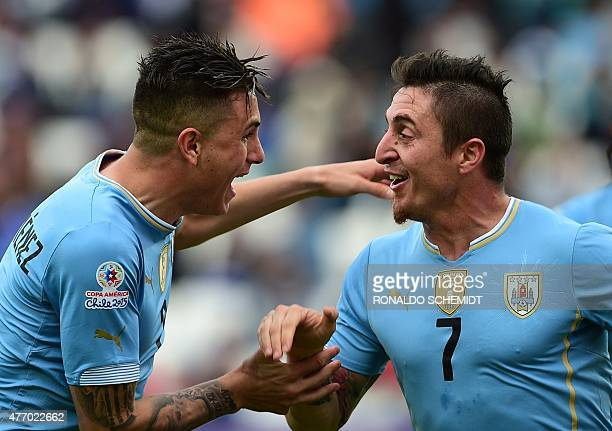 Uruguay's midfielder Cristian Rodriguez celebrates with teammate Jose Maria Gimenez after scoring against Jamaica during their 2015 Copa America...