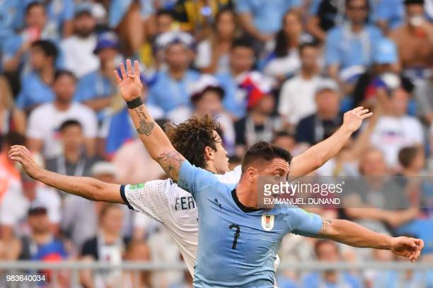 TOPSHOT Uruguay's midfielder Cristian Rodriguez challenges Russia's defender Mario Fernandes during the Russia 2018 World Cup Group A football match...