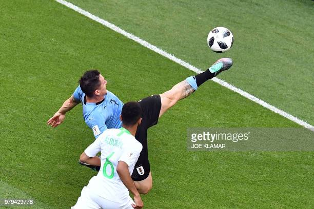 Uruguay's midfielder Cristian Rodriguez fights for the ball with Saudi Arabia's defender Mohammed AlBurayk during the Russia 2018 World Cup Group A...