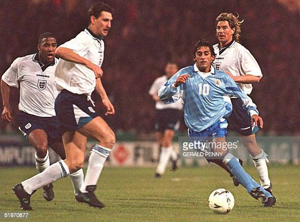 Uruguay's midfielder Enzo Francescoli weaves his way through the English defense John Barnes Tony Adams and Barry Venison 29 March at Wembley Stadium...