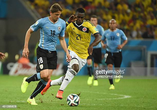 Uruguay's midfielder Gaston Ramirez vies with Colombia's forward Jackson Martinez during the Round of 16 football match between Colombia and Uruguay...