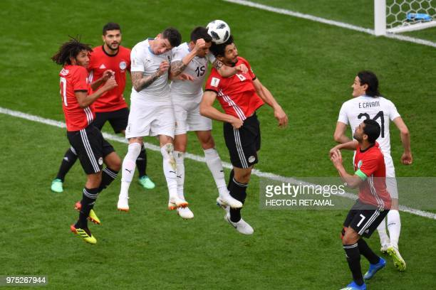 Uruguay's midfielder Matias Vecino goes up for a header against Egypt's defender Ahmed Hegazi during the Russia 2018 World Cup Group A football match...