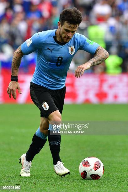 Uruguay's midfielder Nahitan Nandez drives the ball during the Russia 2018 World Cup quarterfinal football match between Uruguay and France at the...