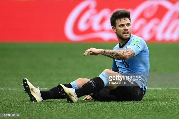 Uruguay's midfielder Nahitan Nandez sits on the ground during the Russia 2018 World Cup quarterfinal football match between Uruguay and France at the...