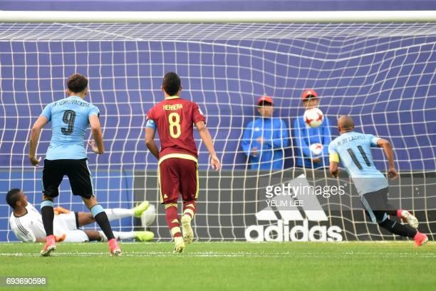 Uruguay's midfielder Nicolas De La Cruz scores a goal during the U20 World Cup semifinal football match between Uruguay and Venezuela in Daejeon on...
