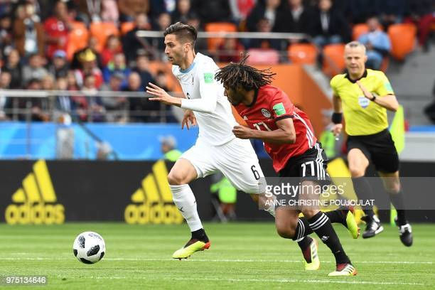 Uruguay's midfielder Rodrigo Bentancur runs with the ball ahead of Egypt's midfielder Mohamed Elneny during the Russia 2018 World Cup Group A...