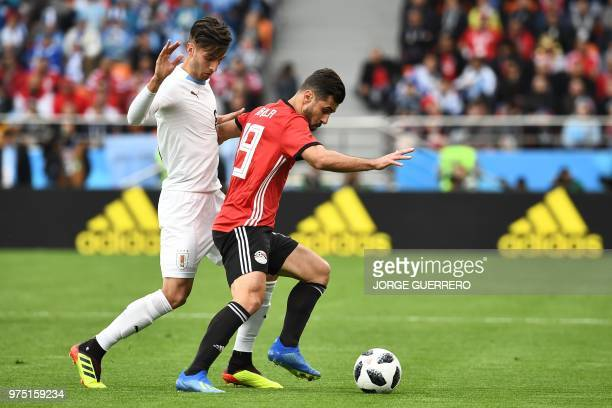 Uruguay's midfielder Rodrigo Bentancur tangles with Egypt's midfielder Abdallah Said during the Russia 2018 World Cup Group A football match between...