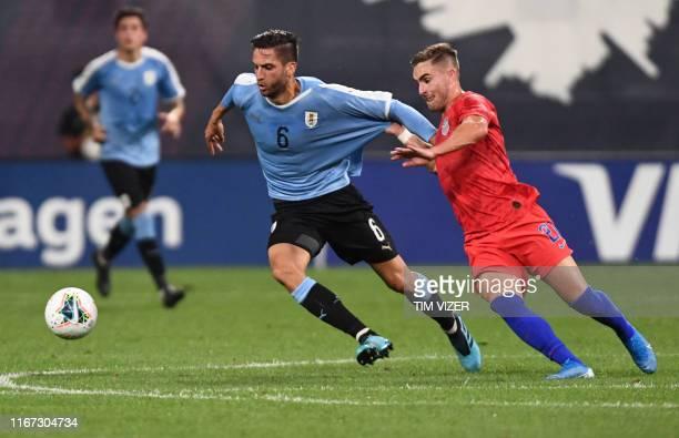 Uruguay's midfielder Rodrigo Bentancur vies for the ball with United States' foward Tyler Boyd during the international friendly football match...