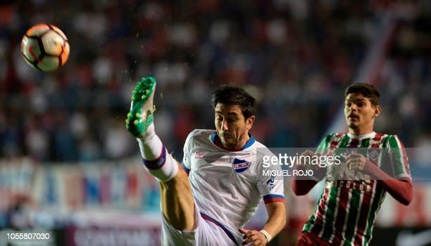 Uruguay's Nacional defender Jorge Fucile kicks the ball followed by Brazil's Fluminense Ayrton Lucas during their Copa Sudamericana secondleg quarter...