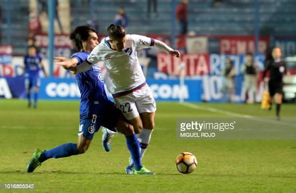 Uruguay's Nacional defender Luis Alfonso Espino and Paraguay's Sol de America midfielder Aldo Vera vie for the ball during their Copa Sudamericana...