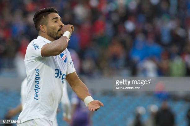 Uruguay's Nacional footballer Rodrigo Aguirre celebrates after scoring against Defensor during the Intermedio tournament final match at the...