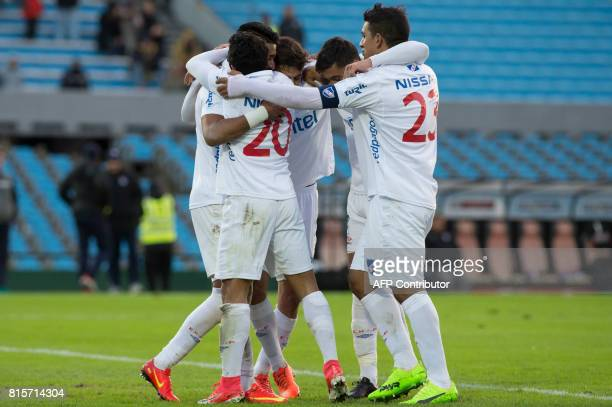 Uruguay's Nacional footballer Rodrigo Aguirre celebrates with teammates after scoring against Defensor during the Intermedio tournament final match...