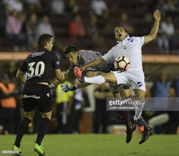 Uruguay's Nacional forward Sebastian Fernandez vies for the ball with Argentina's Lanus goalkeeper Esteban Andrada during the Copa Libertadores 2017...