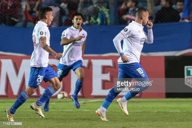 Uruguay's Nacional midfielder Rodrigo Amaral celebrates after scoring a goal during the Copa Libertadores football match against Uruguay's Nacional...