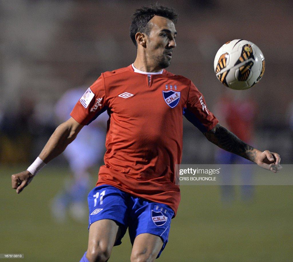 Uruguays Nacional player Vicente Sanchez controls the ball during their 2013 Copa Libertadores football match against Perus Garcilaso, held at the Garcilaso de la Vega stadium, in Cuzco, Peru on April 25, 2013.