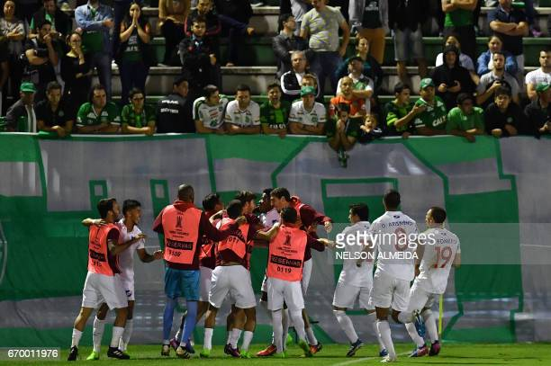 Uruguay's Nacional players celebrate a goal scored by Rodrigo Aguirre against Brazil's Chapecoense during their 2017 Copa Libertadores football match...