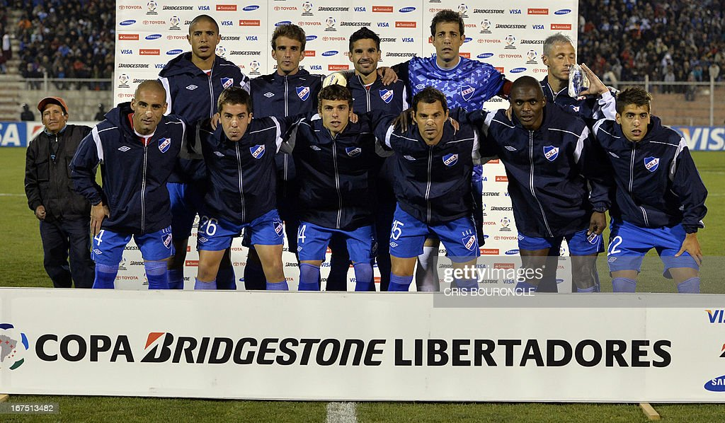 Uruguay's Nacional players pose before their 2013 Copa Libertadores football match against Peru's Garcilaso, held at the Garcilaso de la Vega stadium, in Cuzco, Peru on April 25, 2013.
