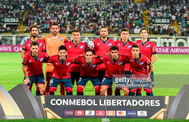 Uruguay's Nacional players pose for pictures before a match against Venezuela's Zamora during their Copa Libertadores 2019 football match at the...