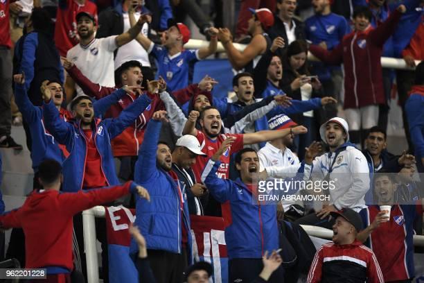 Uruguay's Nacional supporters cheer during the Copa Libertadores group F football match against Argentina's Estudiantes de La Plata at Ciudad de La...