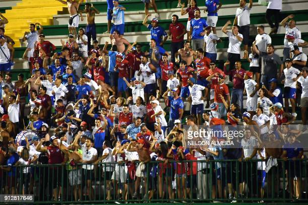 Uruguay's Nacional supporters cheer their team during the Copa Libertadores 2018 football match after defeating Brazil's Chapecoense held at Arena...