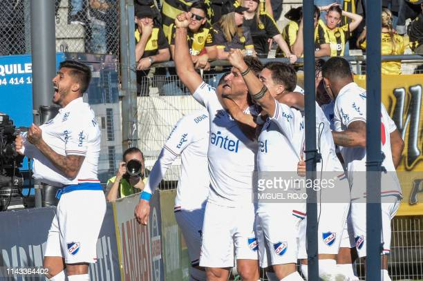 Uruguay's Nacional team players celebrate after scoring a goal during the Uruguayan Apertura 2019 tournament football match against Penarol at the...