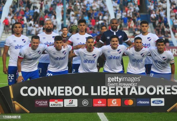 Uruguay's Nacional team players pose for a picture before their Copa Libertadores football match against Venezuela's Estudiantes de Merida at Parque...