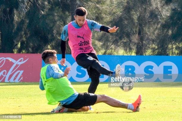 Uruguay's Nahitan Nandez and Jose Maria Gimenez takes part in a training at the Complejo Celeste sports complex in Barros Blancos in Canelones...
