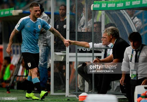Uruguay's Nahitan Nandez shakes hands with coach Oscar Washington Tabarez after being substituted during the Copa America football tournament...