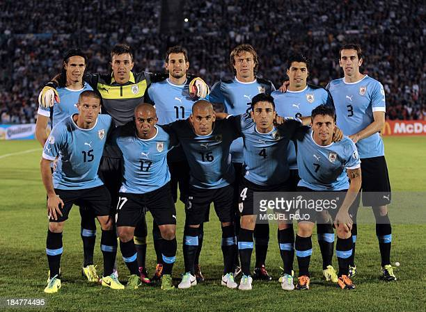 Uruguay's national football team poses for pictures before the start of their Brazil 2014 FIFA World Cup South American qualifier match against...