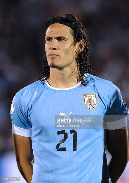 Uruguay's national footballer Edinson Cavani listens to the national anthems before the start of the Brazil 2014 FIFA World Cup South American...