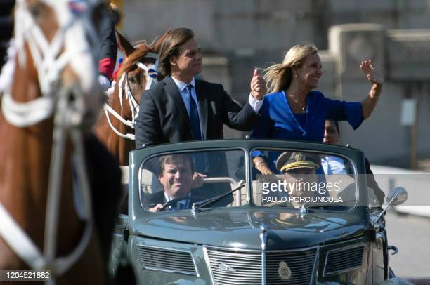 Uruguay's new President Luis Lacalle Pou and VicePresident Beatriz Argimon leave the Legislative Palace to the Plaza Independencia during the...