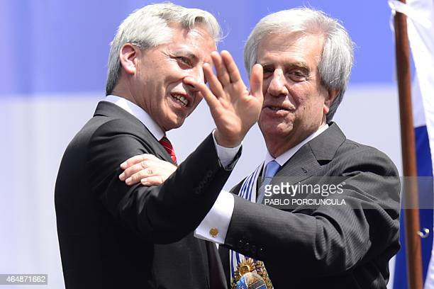 Uruguay's new President Tabare Vazquez is greeted by Bolivian Vice President Alvaro Garcia Linera during his inauguration ceremony at Independencia...