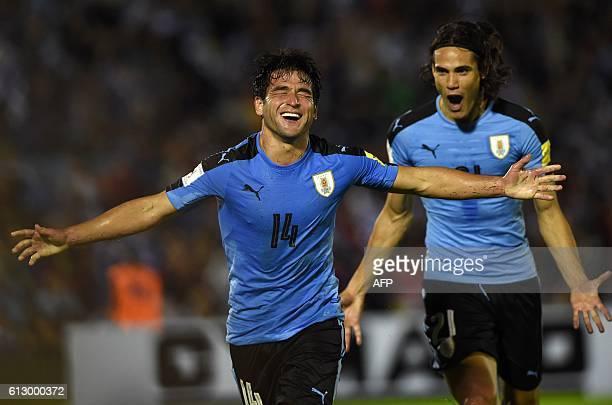 Uruguay's Nicolas Lodeiro celebrates after scoring against Venezuela as teammate Edinson Cavani follows him during their Russia 2018 World Cup...